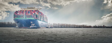 Large Container Ship In Port In Hamburg In Slightly Cloudy Weather