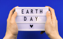 Environment Concept, Earth Day Holiday Celebreation Background With Text Message, Man Hold Lightbox With Lettering