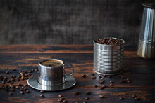 Steel Cup Of Coffee, Blended Coffee Beans In A Tin Can And Geyzer Coffee Maker On A Dark Rustic Wooden Table Among Scattered Coffee Beans, Blended, Vintage
