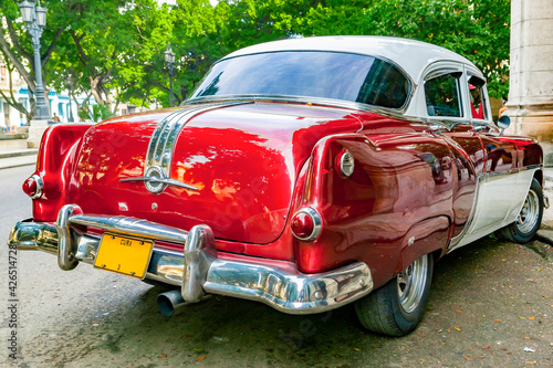 Rear view of red and white vintage 1950's Pontiac parked in Havana, Cuba Wallpaper Mural