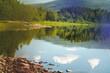 Leinwandbild Motiv Beautiful summer landscape, lake shore and clouds reflecting in water