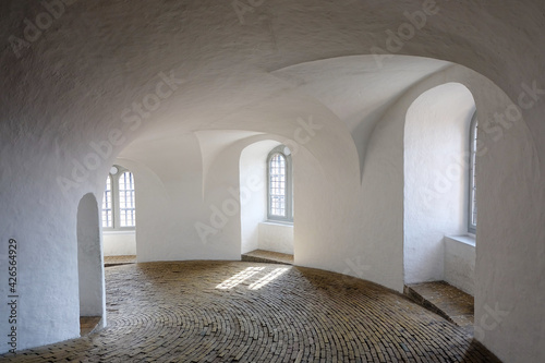 Fotografie, Obraz Aged medieval building with white sailing, walls, and vertical narrow brick floo