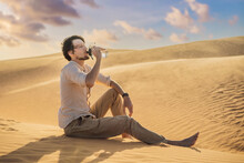 Man Feels Thirst And Drinks Water In The Desert