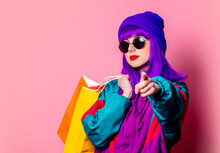 Stylish Shopaholic Girl In 80s Tracksuit And Sunglasses Hold Shopping Bags