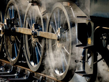 Close Up Of Steam Locomotive Drive Wheels And Steam