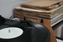 Stylish Turntable With Vinyl Record On Table, Closeup
