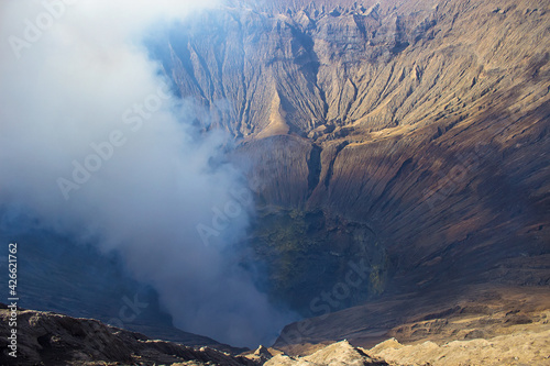 Fotografia, Obraz Crater with active volcano smoke and sulfur, view from the observation deck of erupting and active Bromo volcano