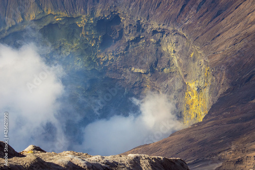 Fotografie, Tablou Closeup view on the big crater with active volcano smoke and sulfur, view from the observation deck of erupting and active Bromo volcano