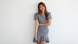 Asian adult pretty woman 20 years old look to feeling happy wearing gray dress smile with happy positve gesture and looking to camera