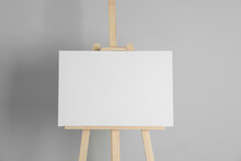 Wooden Easel With Blank Canvas On Light Background