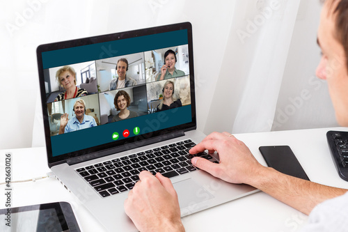 Fototapeta View over businesslady shoulder seated at workplace desk look at computer screen