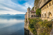 Lake Maggiore, Italy. Eremo Di  Santa Caterina Del Sasso (Hermitage Of Saint Catherine Of Stone - XIII Cen) Overhanging A Big European Lake. It Is One Of The Most Fascinating Historical Sites Of The L