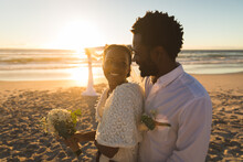 African American Couple In Love Getting Married, Smiling On Beach During Sunset