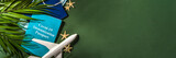 Fototapeta Kawa jest smaczna - Toy airplane, tropical vacation decor and face medical mask on green background. Travel during the coronavirus pandemic concept. Covid-19 immunization passport card