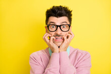 Photo Of Young Handsome Afraid Scared Shocked Stressed Man In Glasses Biting Fingers Isolated On Yellow Color Background