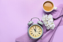 Composition With Alarm Clock And Cup Of Coffee On Color Background
