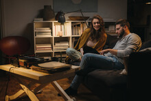 Romantic Young Couple Listening To A Music On Record Player At Home