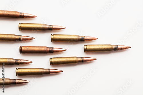 A group of bullet ammunition shells on a white background Fototapet