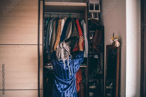 Fototapeta Adult woman choosing outfit gardrobe