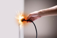 Wet Hand Connecting Electrical Plug Cause Electric Shock, Idea For Causes Of Home Fire, Electric Short Circuit, Electrical Hazard Can Ignite Household Items, Residential Building Electrical Fires.