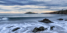 Calm Seas At Bantham Beach With Burgh Island In The Background
