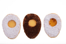 Three Egg Shaped Biscuits With Delicious, Sweet Yellow Filling And Sugar Powder On Top