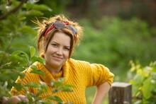 Portrait Beautiful Happy Woman In Garden