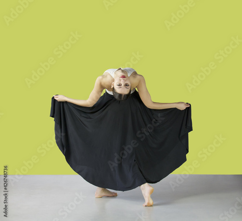 Foto ballerina in back flexion with black long skirt