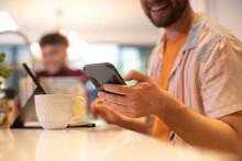 Close Up Young Man Using Smart Phone At Home