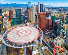 Aerial Shot Of Downtown Los Angeles California. Beautiful Stunning Views Of Downtown High Rise Buildings And Rooftop Helipads. Beautiful Sunny Day.