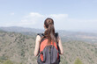 girl with backpack in the mountain