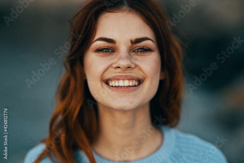 cheerful red-haired woman outdoors nature walk emotions