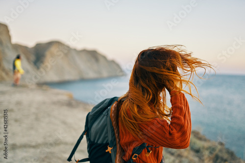 portrait woman travels in the mountains outdoors near the sea cropped view Fototapet