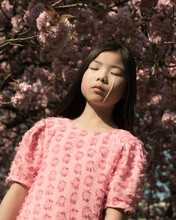 Conceptual Art Portrait Of A Girl In Pink Dress Under A Blossoming Cherry Blossom Tree Woman With Tears Of Pearls