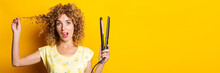 Surprised Young Woman With Curly Hair With Hair Straightener On Yellow Background. Banner.