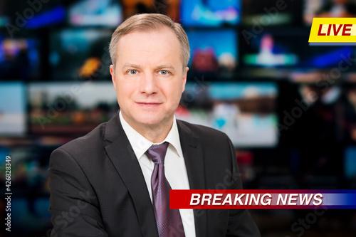 Fotografia, Obraz An anchorman reporting live breaking news sitting in Tv studio