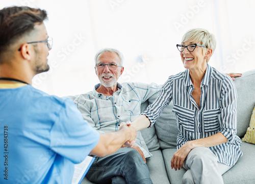 nurse doctor senior care caregiver help assistence retirement home hospital nursing man handshake insurance