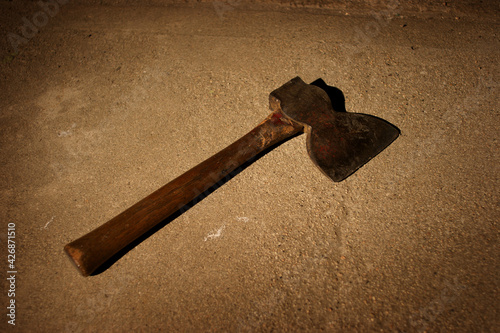 Spooky axe on ground at night #426871510