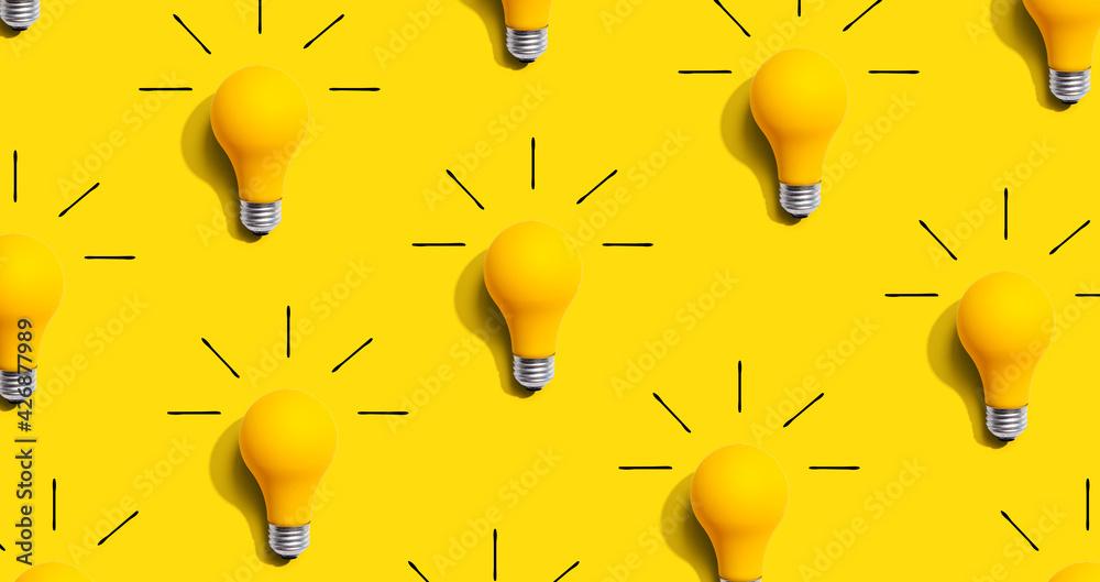 Fototapeta Yellow light bulb pattern with shadow