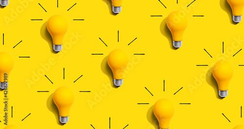 Obraz Yellow light bulb pattern with shadow - fototapety do salonu