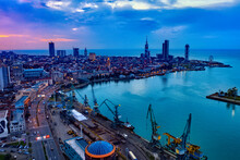 Batumi, Georgia - April 7, 2021: Batumi Port, View Of The City Center From A Cargo Ship In The Port In Bright Summer Sunset Lights