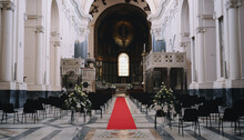 Central Nave Of Salerno Cathedral With Red Carpet And Flowers