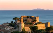 Italy Tuscany Castiglione Della Pescaia, Panoramic Sunset Views Of The Castle, In The Background The Island Of Giglio