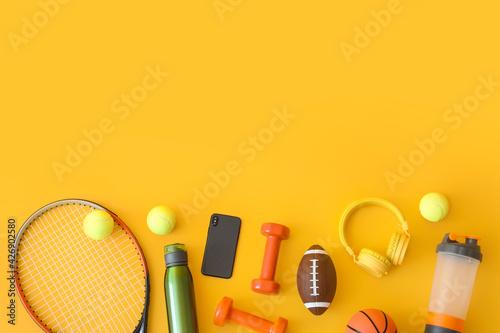Papel de parede Set of sport equipment on color background