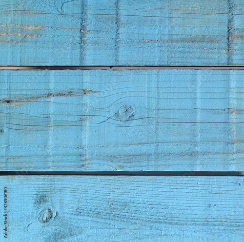 Tableau sur Toile Vertical shtof a blue wooden rood during daytime