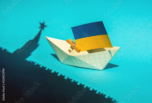 Photo shadow of the Moscow Kremlin over the flag of Ukraine, relations conflict betwee