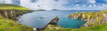 Beautiful Panoramic Shot Of Amazing Dunquin Pier And Harbour With Tall Cliffs, Turquoise Water And Islands, Dingle, Wild Atlantic Way, Kerry, Ireland