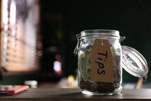 Glass Jar With Tips On Wooden Table Indoors, Closeup. Space For Text