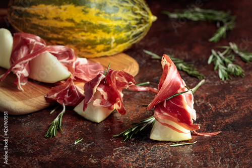 Juicy melon with prosciutto and rosemary.