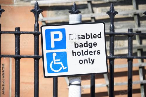 Photo Disabled blue badge holder parking sign for driver